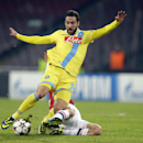 Napoli forward Gonzalo Higuain of Argentina, left, is tackled by Arsenal's Tomas Rosicky, during a Champions League, group F soccer match, at the Naples San Paolo stadium, Italy, Wednesday, Dec. 11, 2013