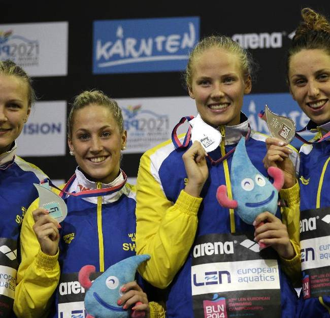Sweden's team show off their silver medal during the ceremony for the women's 4x100m medley relay  at the LEN Swimming European Championships in Berlin, Germany, Sunday, Aug. 24, 2014