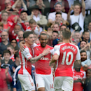 The Latest: Walcott completes hat trick for Arsenal