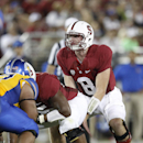 FILE - In this Sept. 7, 2013, file photo, Stanford quarterback Kevin Hogan (8) takes a snap against San Jose State during the second half of an NCAA college football game in Stanford, Calif. It has become common for teams to line up in shotgun formation on short-yardage plays, forgoing the possibility of a quarterback sneak for the ability to use the entire playbook. (AP Photo/Tony Avelar, File)