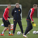 Manchester United's Nemanja Vidic, left, trains with teammates at Carrington training ground in Manchester, Tuesday, April 8, 2014. Manchester United will play Bayern Munich in Germany in a Champions League quarter final second leg soccer match on Wednesd
