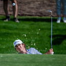 Brooks Koepka of the U.S. chips out of the bunker on the 2nd fairway, during the first day of The DP World Tour Championship, held at Jumeirah Golf Estates in Dubai, United Arab Emirates, on Thursday, Nov. 20, 2014. (AP Photo/Stephen Hindley)