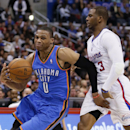The hand of Oklahoma City Thunder guard Russell Westbrook, left, touches Los Angeles Clippers guard Chris Paul, right, as he drives past him during the second half of an NBA basketball game in Los Angeles, Wednesday, April 9, 2014. The Thunder won 107-101