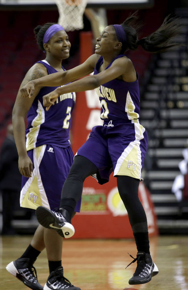 Prairie View A&M's LaReahn Washington (0) celebrates with teammate Shamiya Brooks (2) after defeating Southern in an NCCA college basketball game in the semifinals of the Southwestern Athletic Conference tournament on Friday, March 14, 2014, in Houston. Prairie View A&M won 72-43