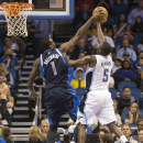 Dallas Mavericks' Samuel Dalembert, left, blocks Orlando Magic's Victor Oladipo's shot during the second half of an NBA basketball game in Orlando, Fla., Saturday, Nov. 16, 2013 The Associated Press