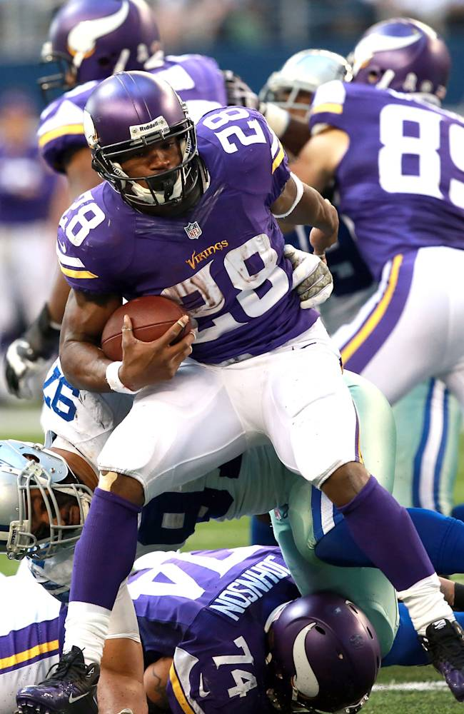 Minnesota Vikings running back Adrian Peterson (28) tackled by Dallas Cowboys defensive tackle Jason Hatcher (97) during the second half of an NFL football game Sunday, Nov. 3, 2013, in Arlington, Texas