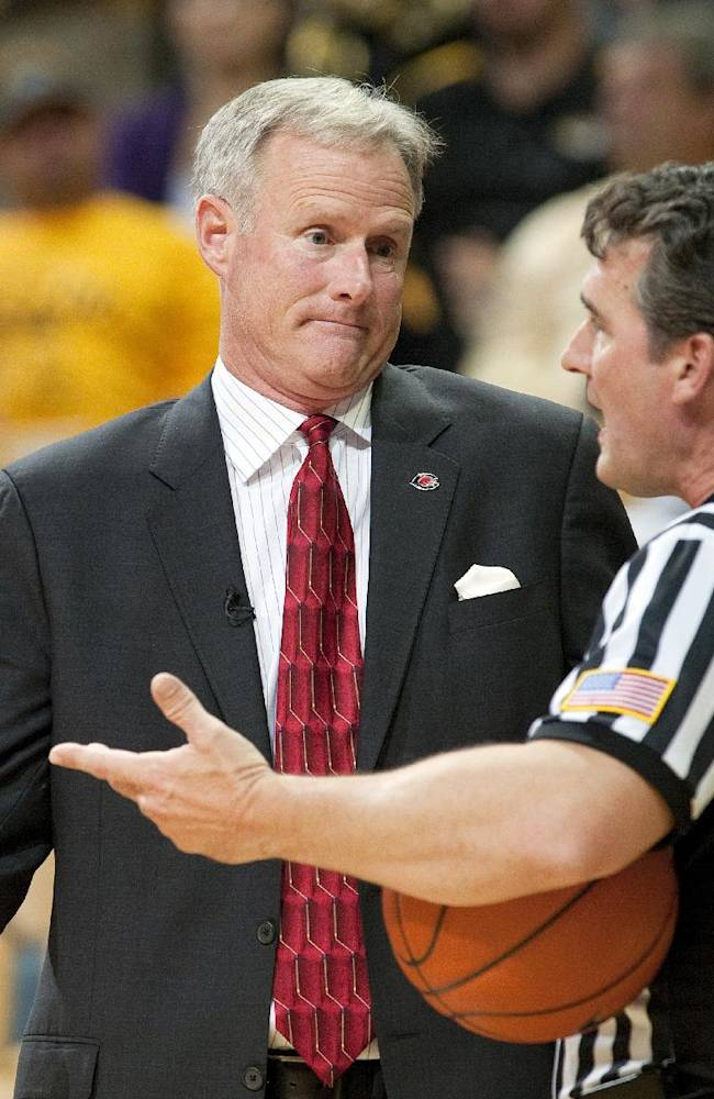 Central Missouri head coach Kim Anderson, left, argues a call with the referee during the second half of an NCAA college basketball exhibition game against Missouri, Friday, Nov. 1, 2013, in Columbia, Mo. Missouri won 92-79