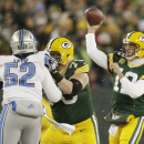 Green Bay Packers' Aaron Rodgers throws during the second half of an NFL football game against the Detroit Lions Sunday, Dec. 28, 2014, in Green Bay, Wis. (AP Photo/Jim Slosiarek)