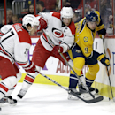 Carolina Hurricanes' Justin Faulk (27) and Eric Staal (12) skate against Nashville Predators' Filip Forsberg (9), of Sweden, during the first period of an NHL hockey game in Raleigh, N.C., Tuesday, Dec. 2, 2014 The Associated Press