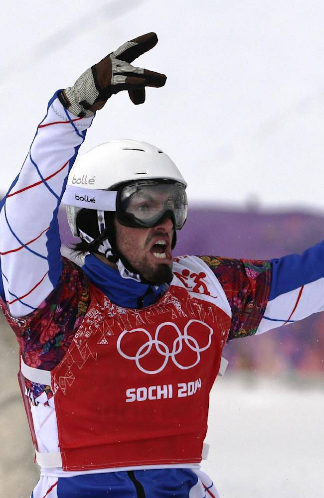 France's Pierre Vaultier celebrates taking the gold medal  in the men's snowboard cross final at the Rosa Khutor Extreme Park, at the 2014 Winter Olympics, Tuesday, Feb. 18, 2014, in Krasnaya Polyana, Russia. Behind him is bronze medalist Alex Deibold of the United States