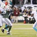 New York Jets tight end Jeff Cumberland (85) bobbles a pass while defended by Miami Dolphins outside linebacker Jelani Jenkins (53) as Miami Dolphins strong safety Reshad Jones (20) moves in to intercept the ball with seconds left in the fourth quarter of