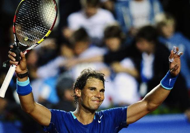 Rafael Nadal of Spain reacts after his victory over Ivan Dodig from Croatia, during the Barcelona open tennis in Barcelona, Spain, Thursday, April 24, 2014