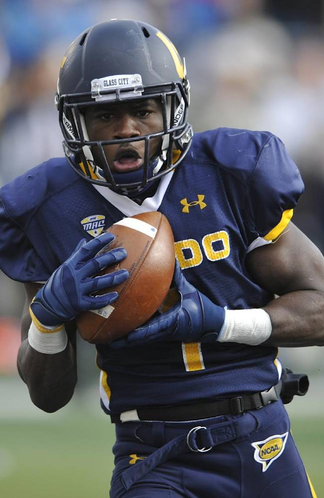 Toledo wide receiver Bernard Reedy catches a touchdown pass against Navy in the second overtime of an NCAA college football game in Toledo, Ohio, Saturday, Oct. 19, 2013. Toledo won 45-44 in double overtime