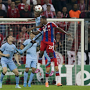 Bayern's David Alaba, right, and Manchester City's Fernandinho, 2. from right, challenge for the ball during the Champions League Group E soccer match between FC Bayern Munich and Manchester City at Allianz Arena in Munich, southern Germany, Wednesday Sep