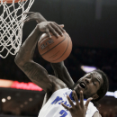 Memphis' Shaq Goodwin (2) grabs a defensive rebound in the first half of an NCAA college basketball game against Louisville in Memphis, Tenn., Saturday, March 1, 2014. Memphis defeated Louisville 72-66. (AP Photo/Danny Johnston)