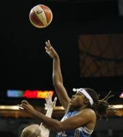 Minnesota Lynx's Rebekkah Brunson, right, shoots over Seattle Storm's Katie Smith during the first half of a WNBA basketball first-round playoff game, Sunday, Sept. 30, 2012, in Seattle. (AP Photo/Kevin P. Casey)