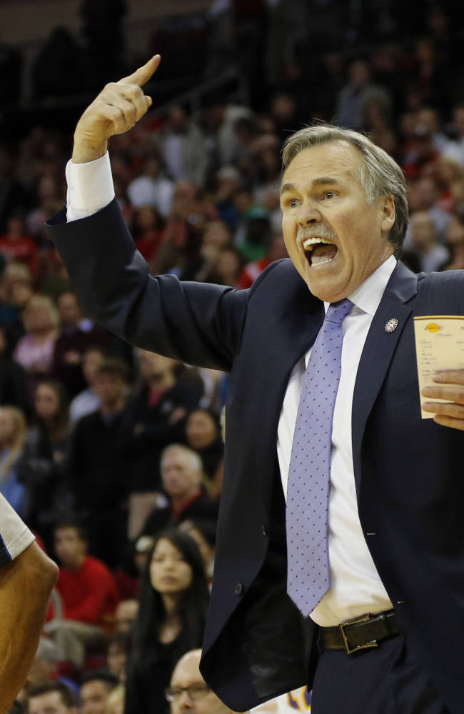 Los Angeles Lakers coach Mike D'Antoni argues a call during the fourth quarter of an NBA basketball game against the Houston Rockets Thursday, Nov. 7, 2013, in Houston. The lakers won 99-98