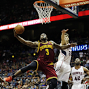 Cleveland Cavaliers' Dion Waiters, left, jumps past the defense of Atlanta Hawks' Kyle Korver to score a basket in the fourth quarter of an NBA basketball game, Friday, April 4, 2014, in Atlanta The Associated Press