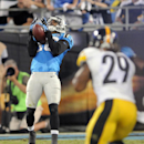 Carolina Panthers' Philly Brown (16) muffs a punt as Pittsburgh Steelers' Shamarko Thomas (29) closes in during the second half of an NFL football game in Charlotte, N.C., Sunday, Sept. 21, 2014. Pittsburgh recovered the ball in the end zone for a touchdo