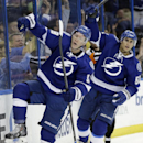 Tampa Bay Lightning left wing Ondrej Palat (18), of the Czech Republic, celebrates with teammate Valtteri Filppula (51), of Finland, after scoring against the Calgary Flames during the second period of an NHL hockey game on Thursday, April 3, 2014, in Tam