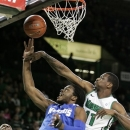 Marshall's Nigel Spikes, right, blocks a shot by Memphis' Shaq Goodwin during the first half of an NCAA college basketball game on Saturday, Feb. 16, 2013, at the Cam Henderson Center in Huntington, W.Va. (AP Photo/Randy Snyder)