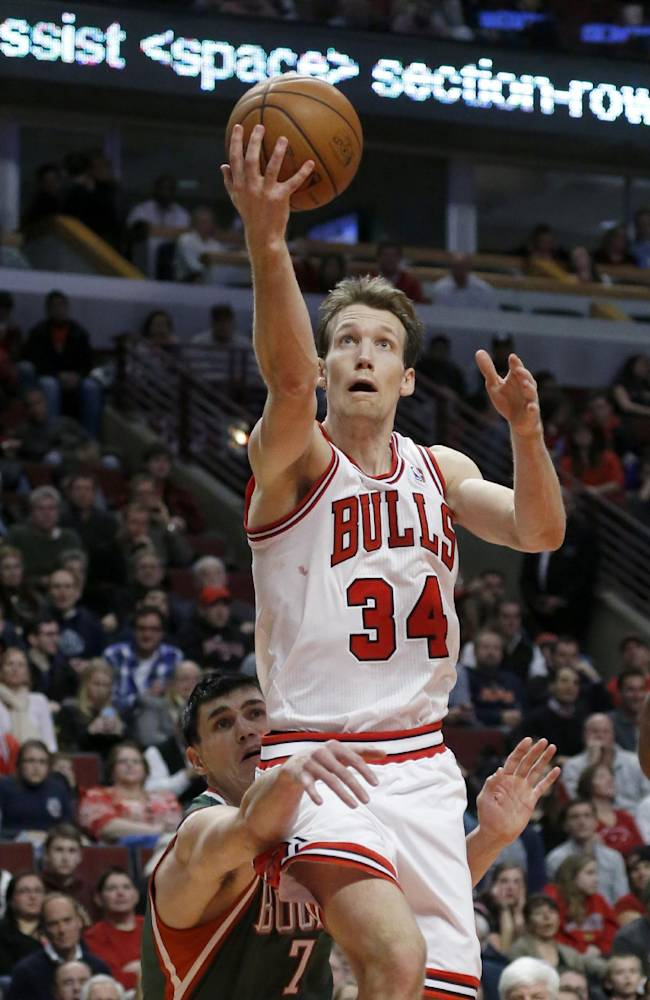 Chicago Bulls small forward Mike Dunleavy (34) drives and scores past Milwaukee Bucks power forward Ersan Ilyasova (7) during the second half of an NBA basketball game Tuesday, Dec. 10, 2013, in Chicago. The Bucks won 78-74