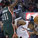 Toronto Raptors' Kyle Lowry, right, is fouled by Milwaukee Bucks' Brandon Knight during first half NBA basketball action in Toronto on Monday, April 14, 2014 The Associated Press