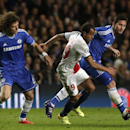 Paris Saint-Germain's Lucas, centre takes the ball past Chelsea's Frank Lampard, right and his teammate David Luiz during the Champions League quarterfinal second leg soccer match between Chelsea and Paris Saint Germain at Stamford Bridge stadium in Londo
