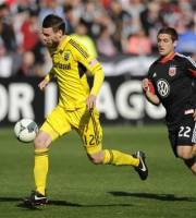 Columbus Crew midfielder Eddie Gaven (12) chases the ball against D.C. United defender Chris Korb (22) during the second half of an MLS soccer game on Saturday, March 23, 2013, in Washington. Columbus won 2-1. (AP Photo/Nick Wass)