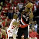 Portland Trail Blazers' LaMarcus Aldridge (12) keeps the ball from Houston Rockets' Dwight Howard, left, during the third quarter in Game 2 of an opening-round NBA basketball playoff series Wednesday, April 23, 2014, in Houston. Portland won 112-105 The A
