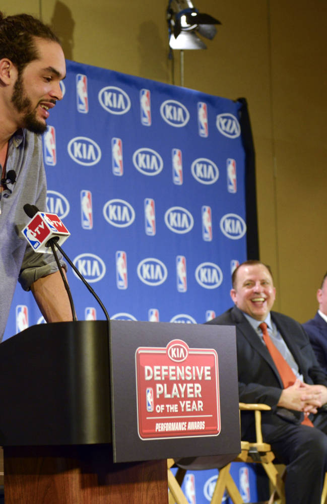 Chicago Bulls center Joakim Noah answers questions from the media after being awarded the NBA's Defensive Player of the Year award, Monday, April 21, 2014, in Lincolnshire, Ill