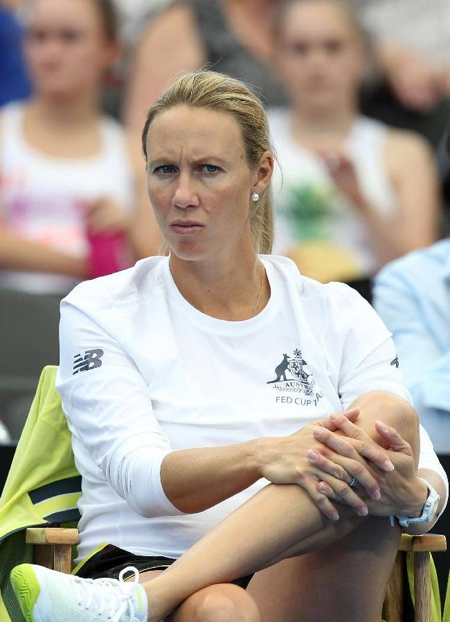 Australian team captain Alicia Molik watches her teammate Samantha Stosur playing against Andrea Petkovic of Germany during the Fed Cup semifinals between Australia and Germany in Brisbane, Australia, Saturday, April 19, 2014