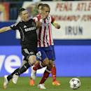 Chelsea's Fernando Torres, left holds of the challenge of Atletico's Miranda during the Champions League semifinal first leg soccer match between Atletico Madrid and Chelsea at the Vicente Calderon stadium in Madrid, Spain, Tuesday, April 22, 2014