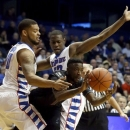 Cincinnati guard Cashmere Wright, center, splits the defense of DePaul center Derrell Robertson Jr., left, and Charles McKinney during the first half of an NCAA college basketball game, Tuesday, Jan. 15, 2013, in Rosemont, Ill. (AP Photo/Charles Rex Arbogast)