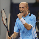 FILE - In this Nov. 15, 2008, file photo, Nikolay Davydenko of Russia celebrates his win over Andy Murray to reach the finals in the 2008 Tennis Masters Cup in Shanghai, China. Former third-ranked player Davydenko has confirmed his retirement from tennis. Davydenko has not played on the ATP tour since the French Open in May and made his announcement on the sidelines of the Kremlin Cup tournament in Moscow on Thursday, Oct. 16, 2014. (AP Photo/Bullit Marquez, File)