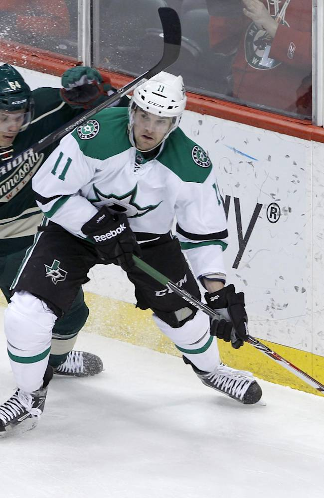 Dallas Stars center Dustin Jeffrey (11) controls the puck in front of Minnesota Wild center Mikael Granlund, left, of Finland, during the first period of an NHL hockey game in St. Paul, Minn., Saturday, Jan. 18, 2014