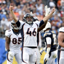 Denver Broncos long snapper Aaron Brewer celebrates a field goal by kicker Connor Barth during the second half of an NFL football game against the San Diego Chargers, Sunday, Dec. 14, 2014, in San Diego The Associated Press