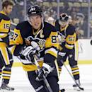 Pittsburgh Penguins' Sidney Crosby (87) warms up before the Penguins' NHL hockey game against the Colorado Avalanche in Pittsburgh on Thursday, Dec. 18, 2014. (AP Photo/Gene J. Puskar