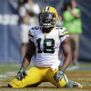 Green Bay Packers wide receiver Randall Cobb (18) reacts after missing a catch in the end zone in the second half of an NFL football game against the Chicago Bears Sunday, Sept. 28, 2014, in Chicago. The Associated Press