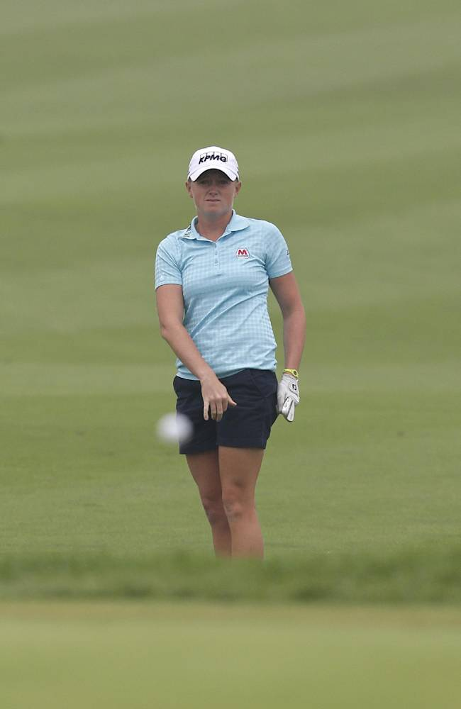 Stacy Lewis of the United States follows her ball after chipping it onto the ninth green during the final round of the Reignwood LPGA Classic golf tournament at Pine Valley Golf Club on the outskirts of Beijing, China, Sunday, Oct. 6, 2013