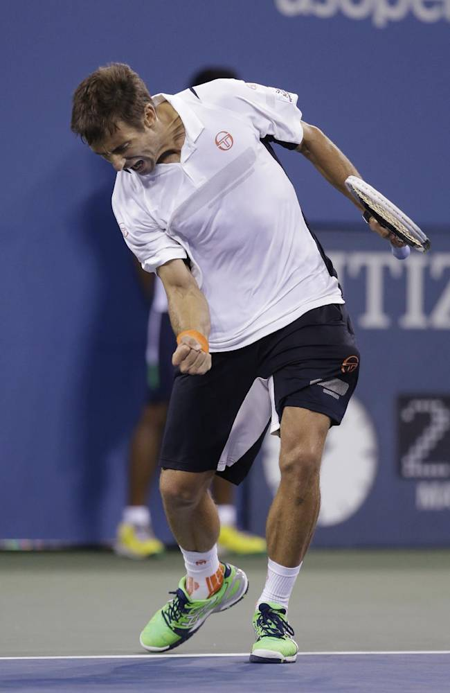 Tommy Robredo, of Spain, reacts after defeating Nick Kyrgios, of Australia, in the third round of the U.S. Open tennis tournament Sunday, Aug. 31, 2014, in New York