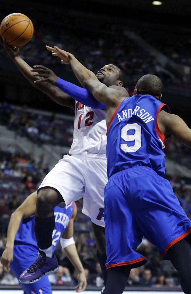 Detroit Pistons guard Will Bynum (12) is fouled by Philadelphia 76ers guard James Anderson (9) while going to the basket during the second half of an NBA basketball game Saturday, Feb. 1, 2014, in Auburn Hills, Mich. The Pistons won 113-96