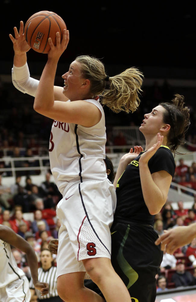 Stanford forward Mikaela Ruef, left, shoots next to Oregon forward Danielle Love during the second half of an NCAA college basketball game on Friday, Jan. 3, 2014, in Stanford, Calif