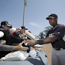New York Yankees fans clamor for an autograph from Yankees designated hitter Alfonso Soriano before the team's exhibition baseball game against the Toronto Blue Jays in Dunedin, Fla., Wednesday, March 26, 2014 The Associated Press