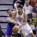 New York Knicks' Cole Aldrich (45) knocks the ball from Utah Jazz's Enes Kanter (0) in the first quarter during an NBA basketball game Monday, March 31, 2014, in Salt Lake City The Associated Press