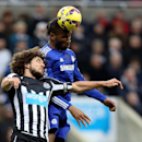 Newcastle United's captain Fabricio Coloccini, left, vies for the ball with Chelsea's Didier Drogba during their English Premier League soccer match at St James' Park, Newcastle, England, Saturday, Dec. 6, 2014