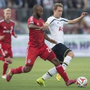 Tottenham Hotspur's Christian Eriksen, right, and Toronto FC's Collen Warner battle for the ball during the first half of a friendly soccer match in Toronto on Wednesday, July 23, 2014