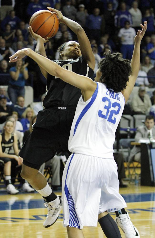 Vanderbilt's Christina Foggie, left, shoots under pressure from Kentucky's Kastine Evans (32) during the second half of an NCAA college basketball game on Sunday, March 2, 2014, in Lexington, Ky. Kentucky won 65-63