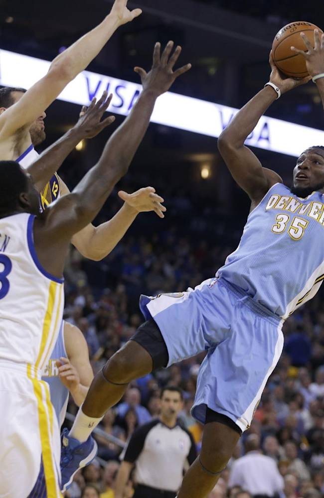 Denver Nuggets' Kenneth Faried, right, shoots against Golden State Warriors' Draymond Green (23) and Andrew Bogut during the first half of an NBA basketball game Thursday, April 10, 2014, in Oakland, Calif