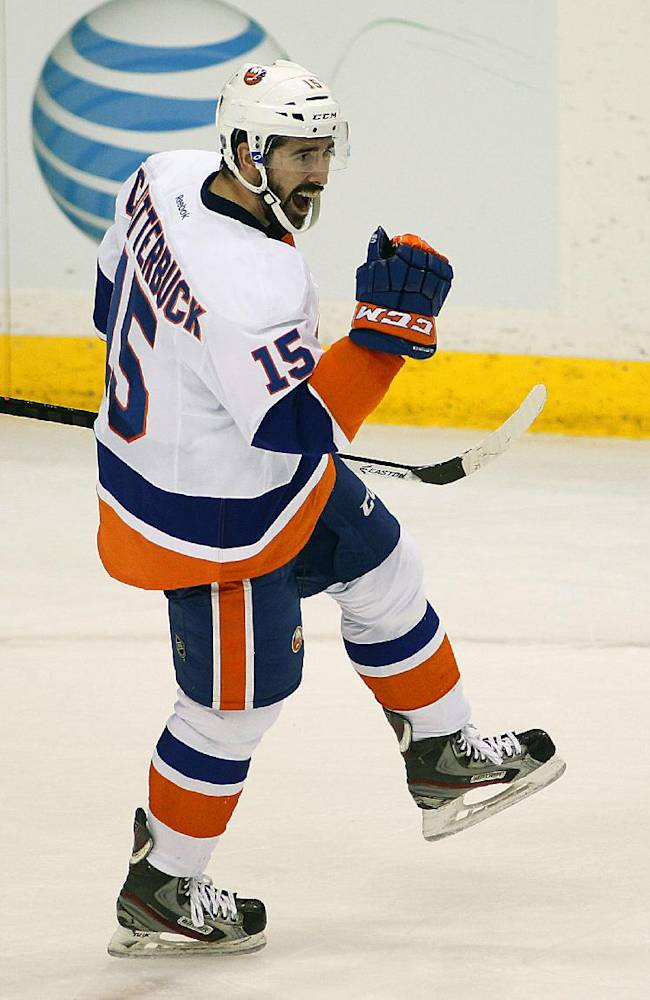 New York Islanders forward Cal Clutterbuck celebrates his goal against his former team the Minnesota Wild during the second period of their NHL hockey game, Sunday, Dec. 29, 2013, in St. Paul, Minn